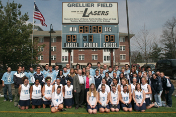 Nancy Grellier with members of field hockey and lacrosse teams