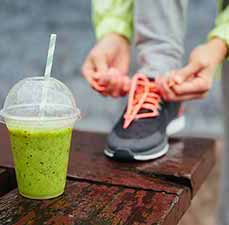 green shake, person tying shoe
