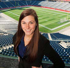 student standing at Gillette Stadium